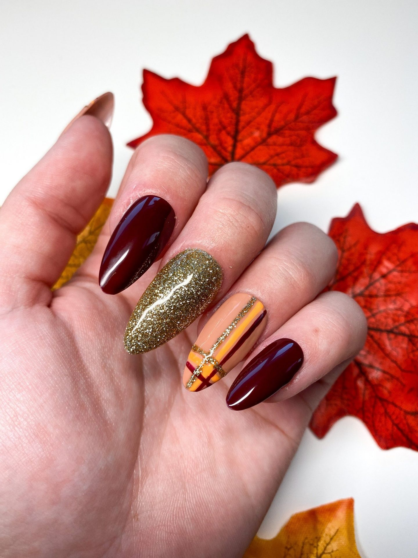 Plum Thanksgiving nails with gold and tartan nail art