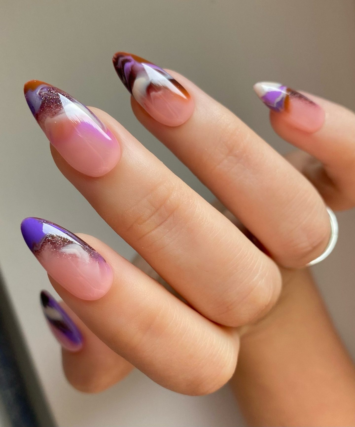 Cute purple and brown almond nails with smoke effect