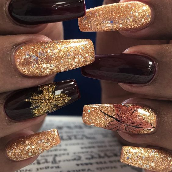 Cute Thanksgiving nails with gold glitter and brown nail polish