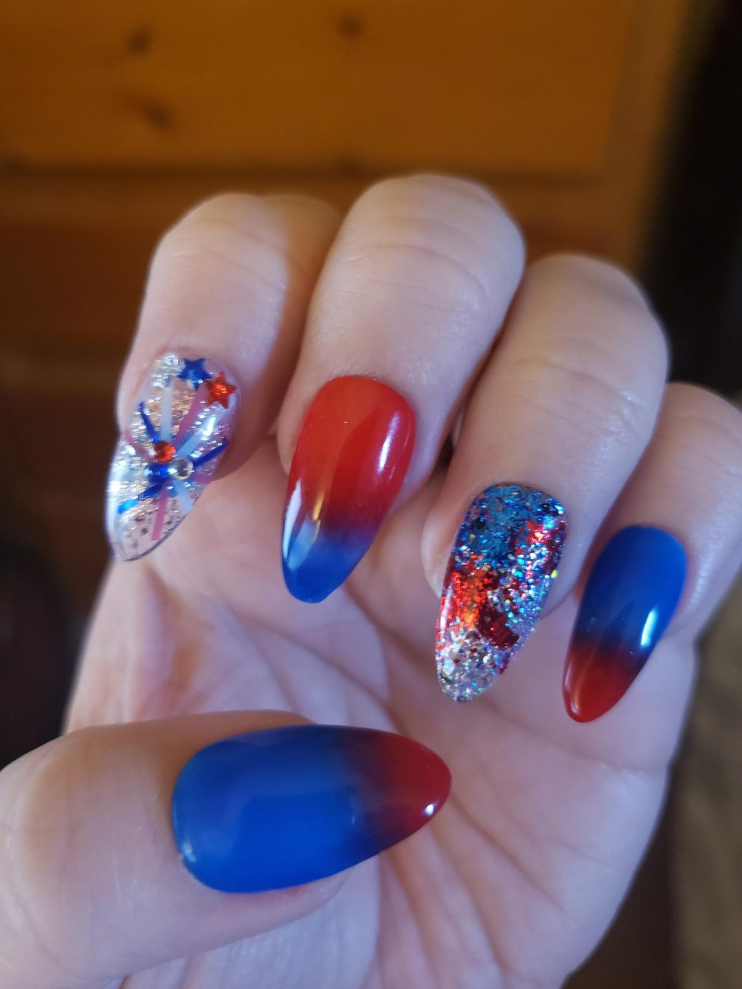 Red and blue ombre nails with glitter