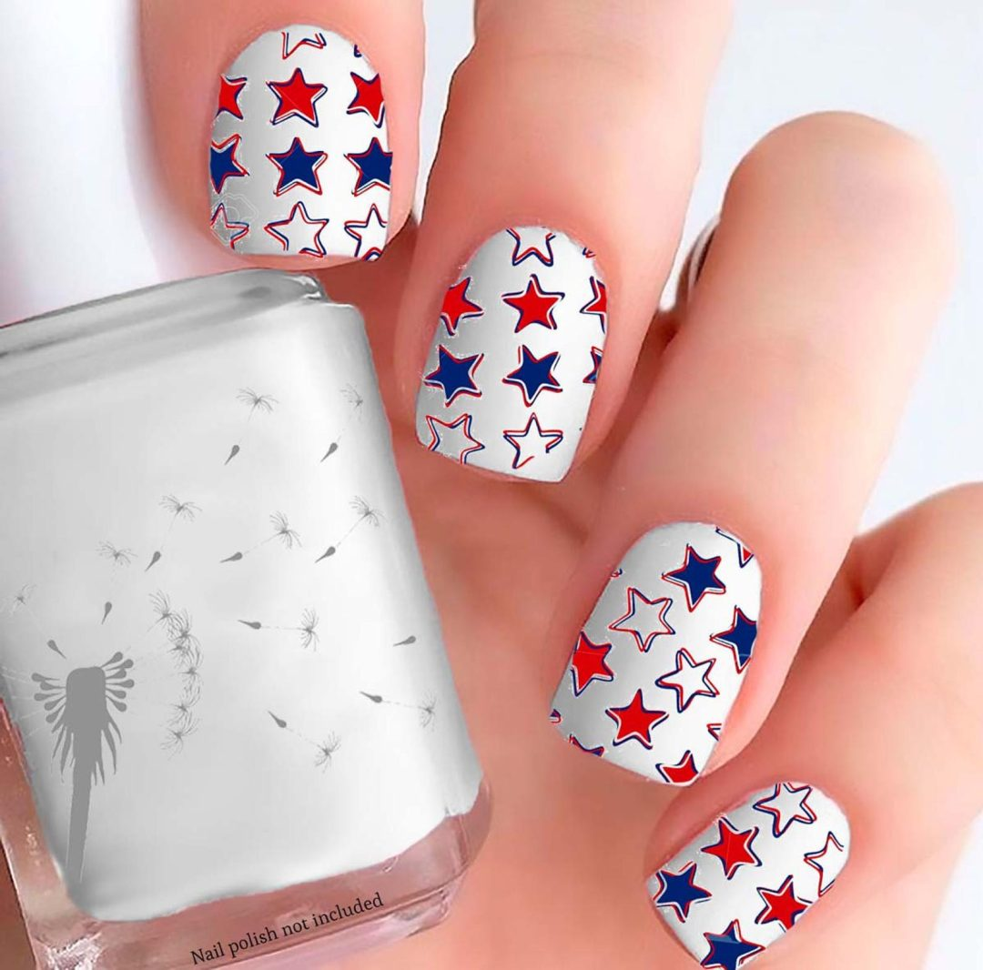Short white nails with star nail art in red and blue