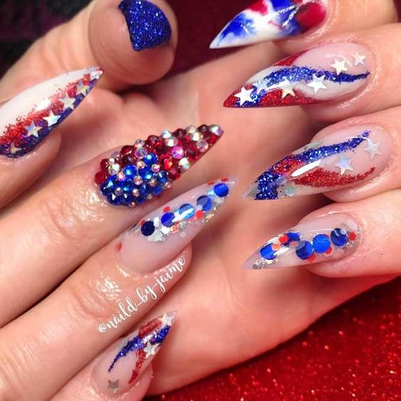 Beautiful acrylic 4th of July nails with rhinestones