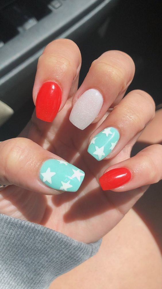 Light blue, white and red nails with star nail art