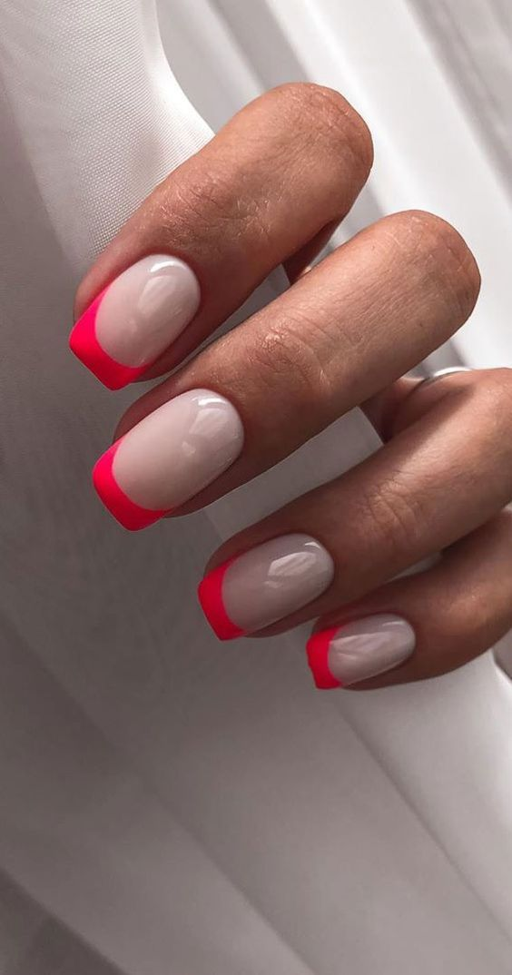 Bright pink French tip nails
