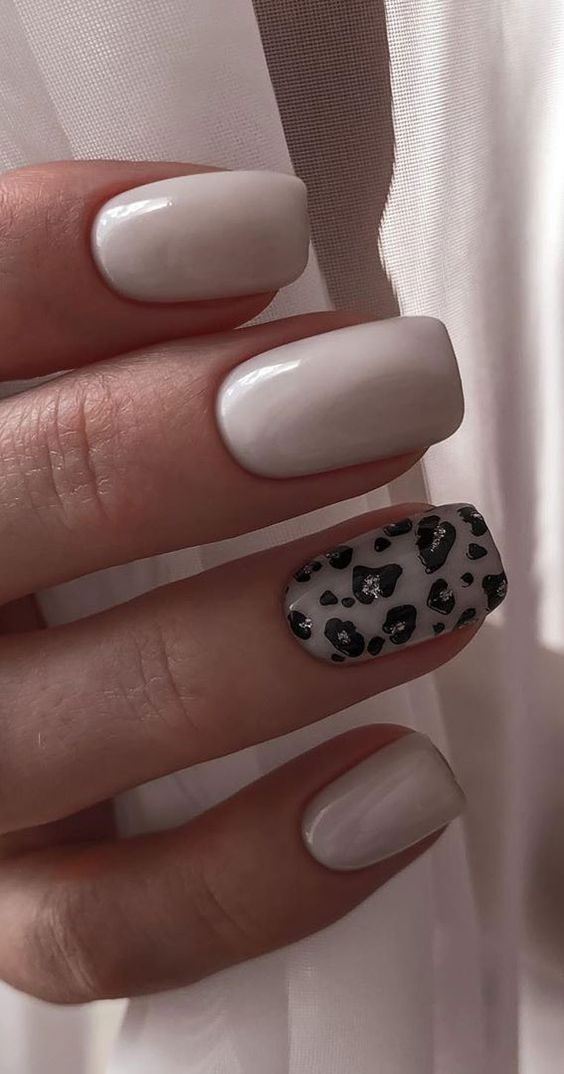 Pastel pink nails with leopard print nail art