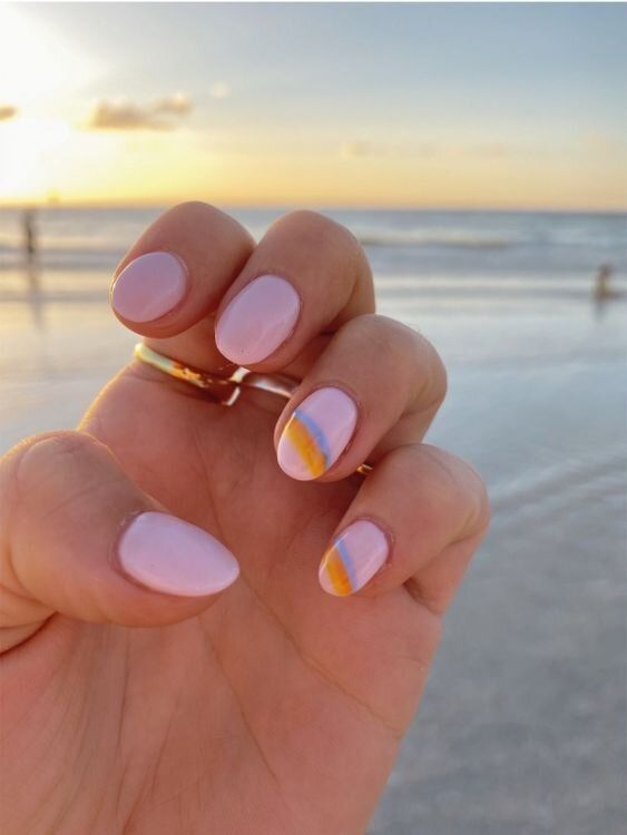 Pastel pink nails with rainbow