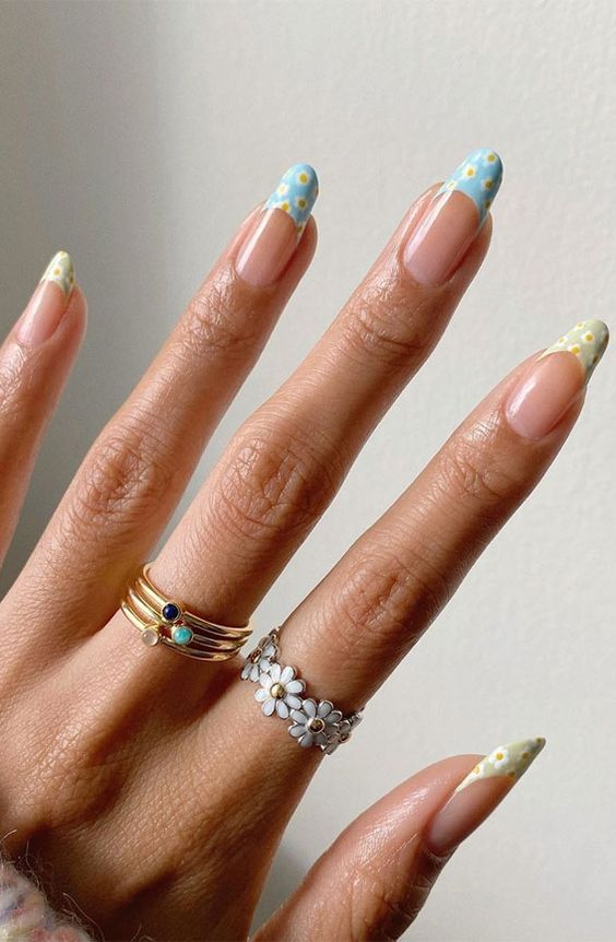 Floral French tip nails with blue flower nail art