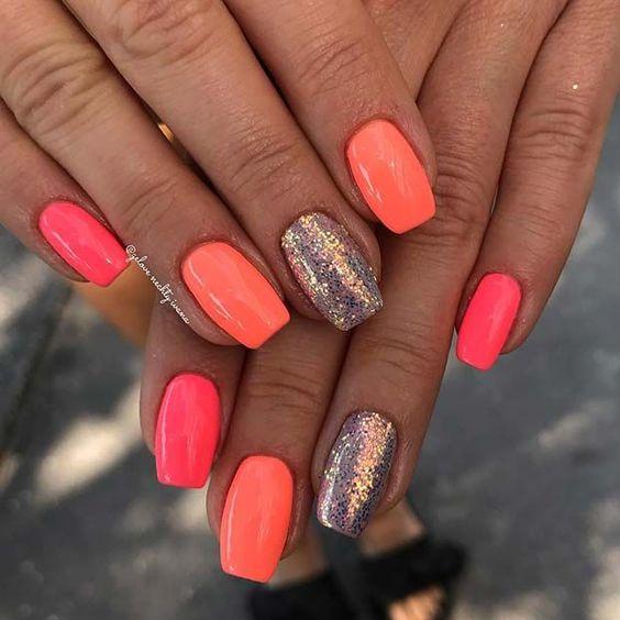 Cute orange summer nails with glitter