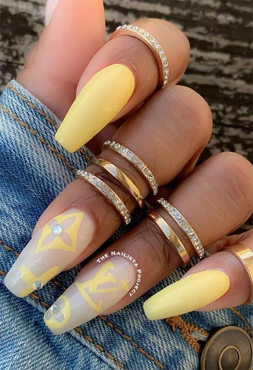 Pastel yellow nail with Louis Vuitton nail art in coffin shape