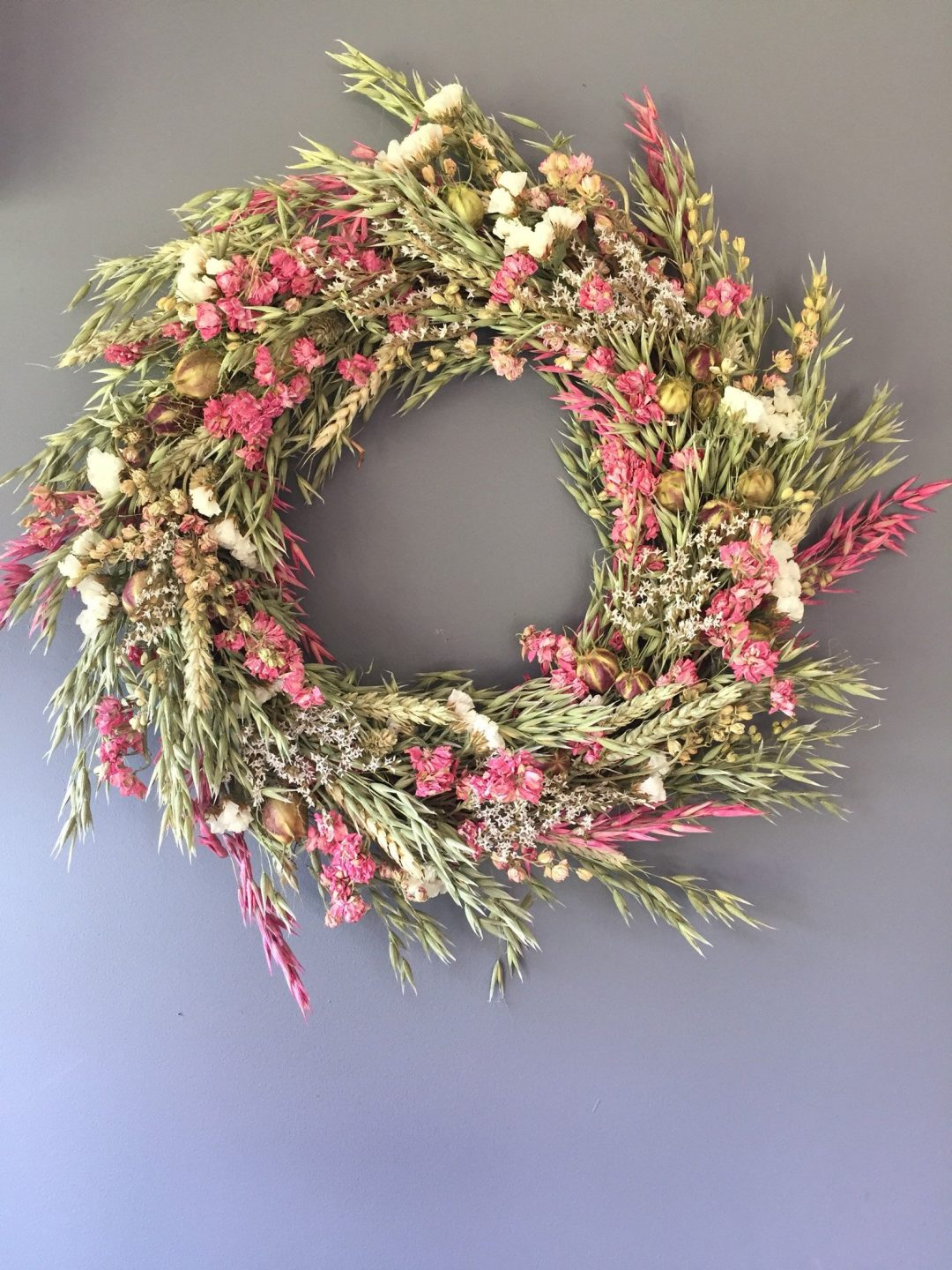 Dried wreaths with flowers and wheat