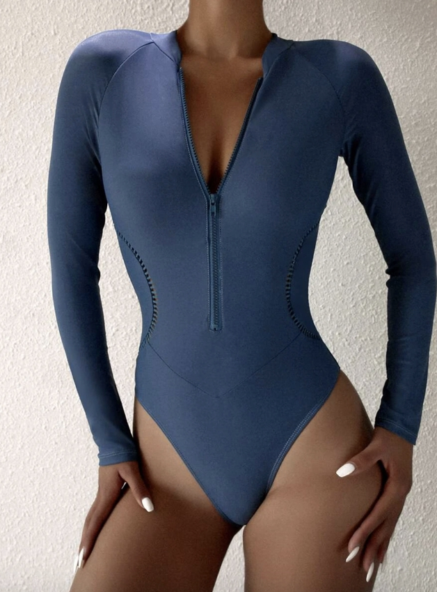Navy blue long sleeve one piece swimsuit that covers back acne and shoulders