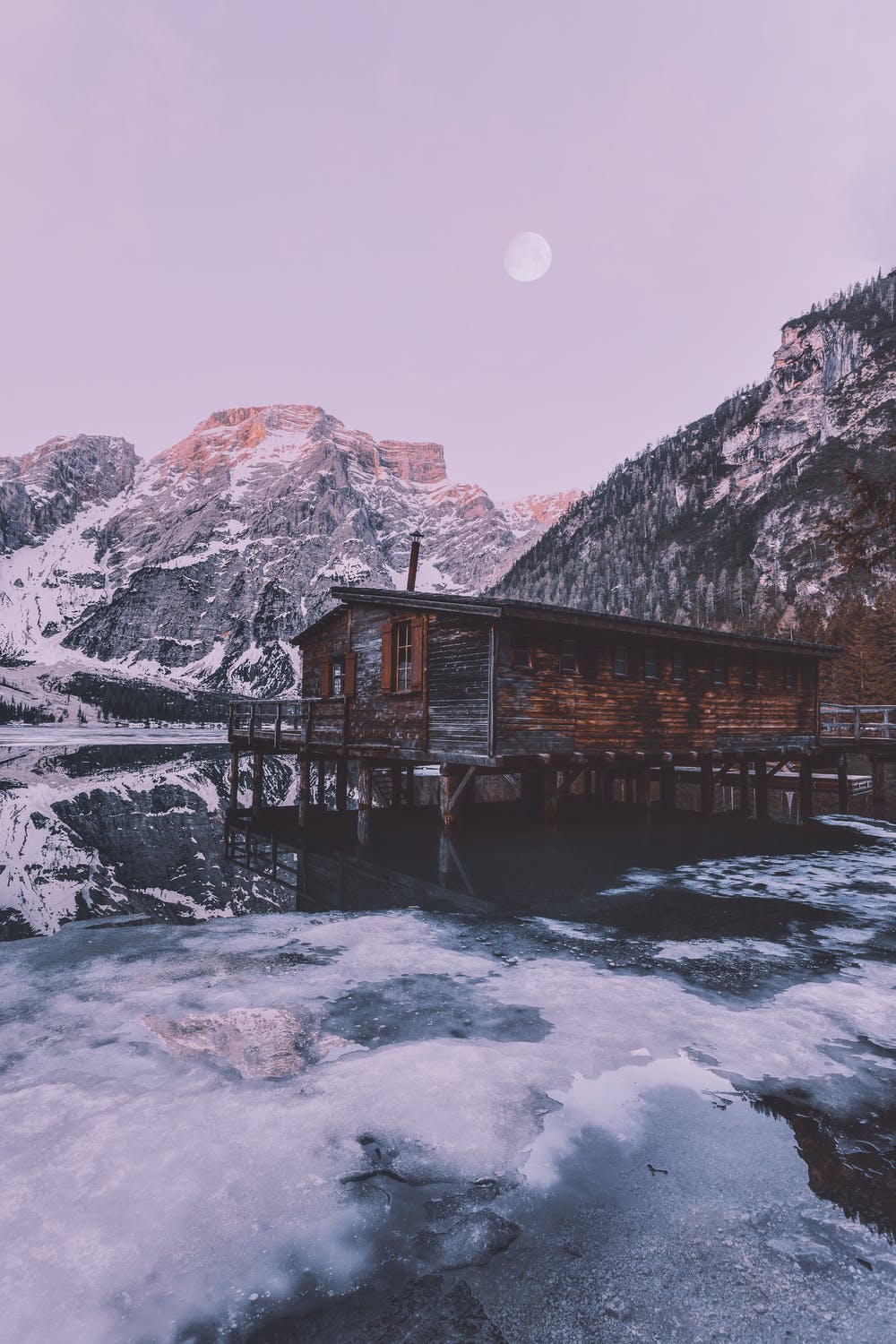 Purple skies wallpaper with mountains, lake and cottage