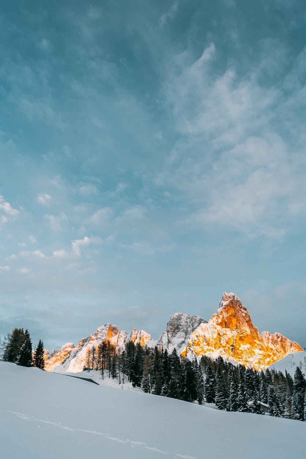 Snow wallpaper with mountains and blue sky