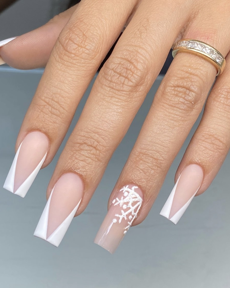 Modern white French tip nail designs with snowflakes
