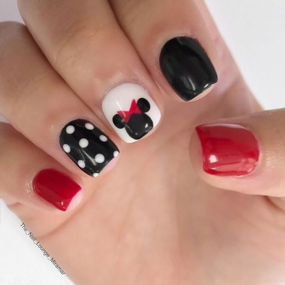 Short Disney nails with black, red and white.