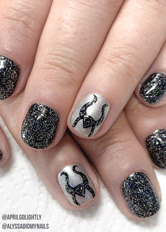 Black Maleficent Disney nails with glitter