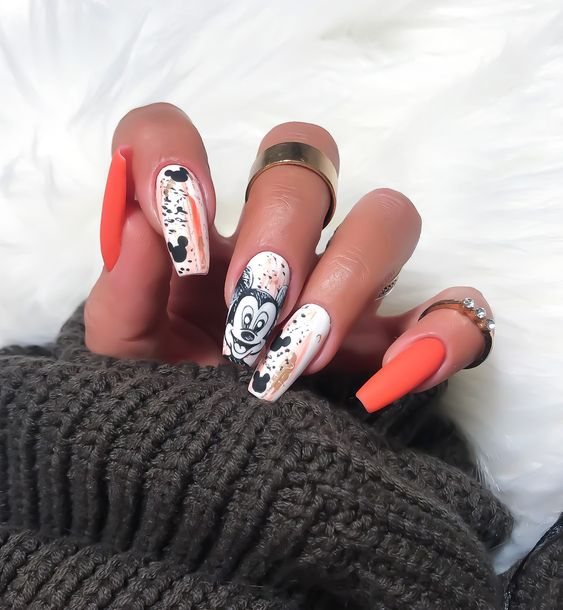 Cute orange Mickey Mouse nails