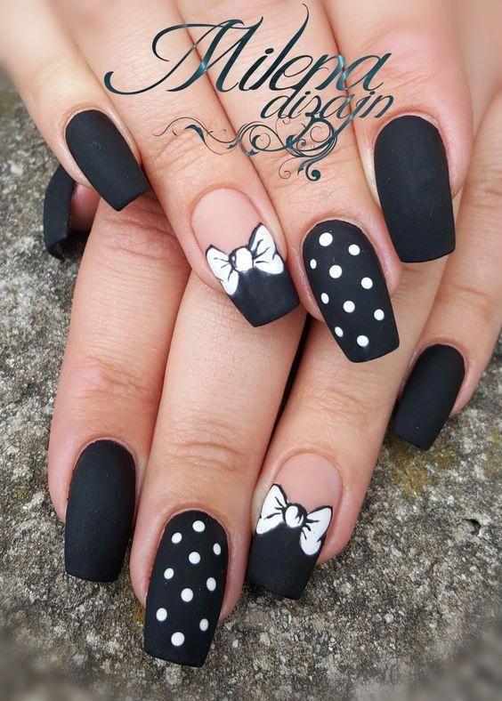 Matte black Disney nails with polka dots