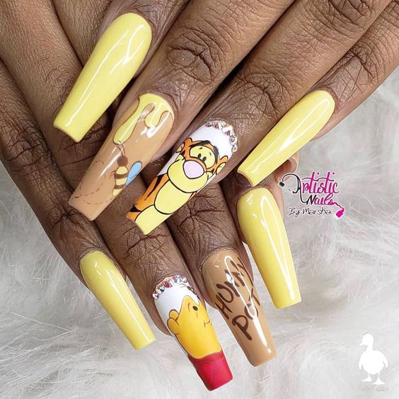 Yellow Winnie The Pooh nails in acrylic coffin nail shape