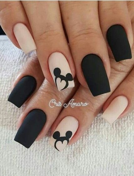 Matte nude and black Disney nails