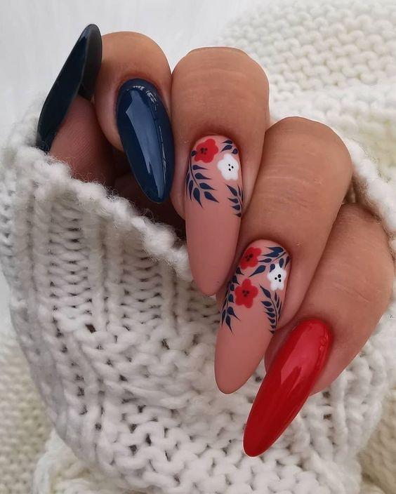 Acrylic flower nails with blue, red and neutral hues