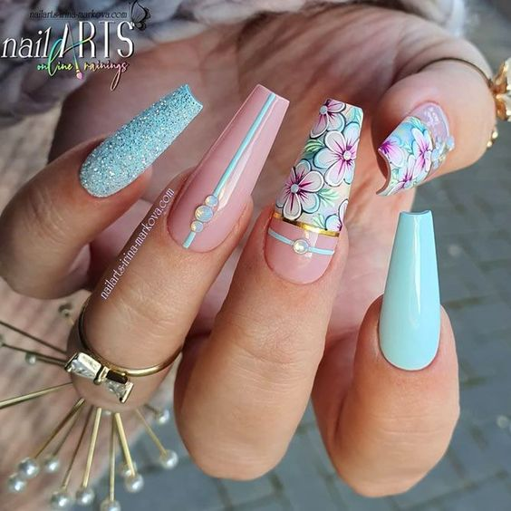 Pink and blue flower nail designs in acrylic coffin shape