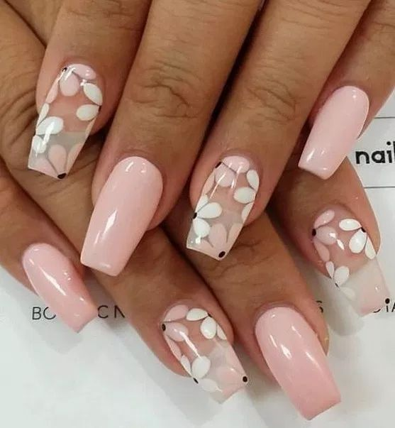 Light pink flower nails in acrylic coffin shape