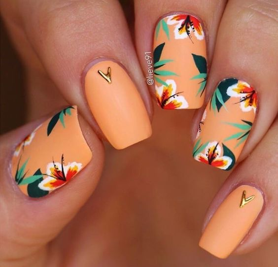 Matte orange and tropical flower nails