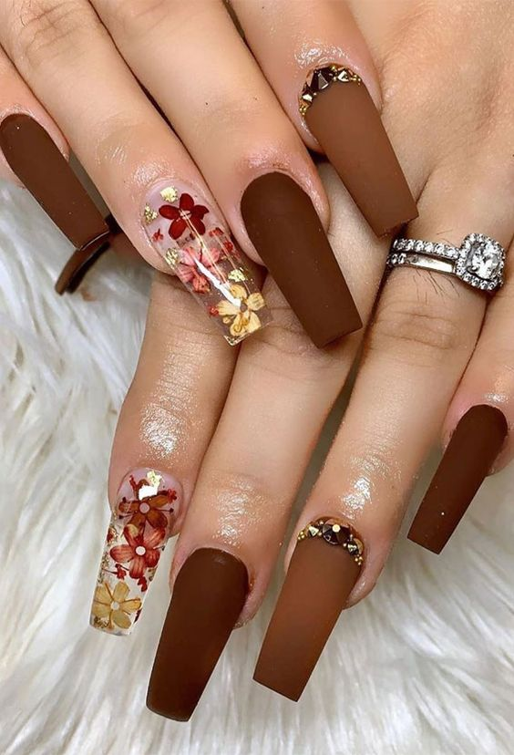 Brown nails with flower design, in acrylic coffin shape