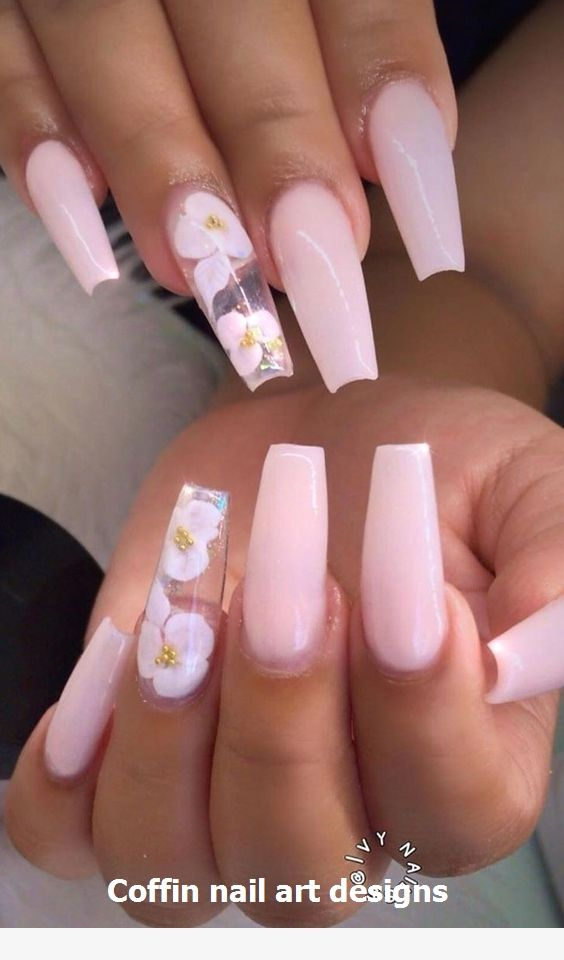 Light pink acrylic coffin nails with nail art design