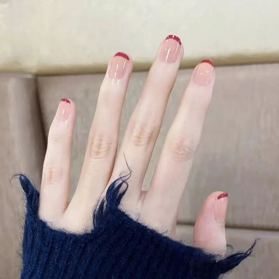 Modern brown French tip nails on short nails