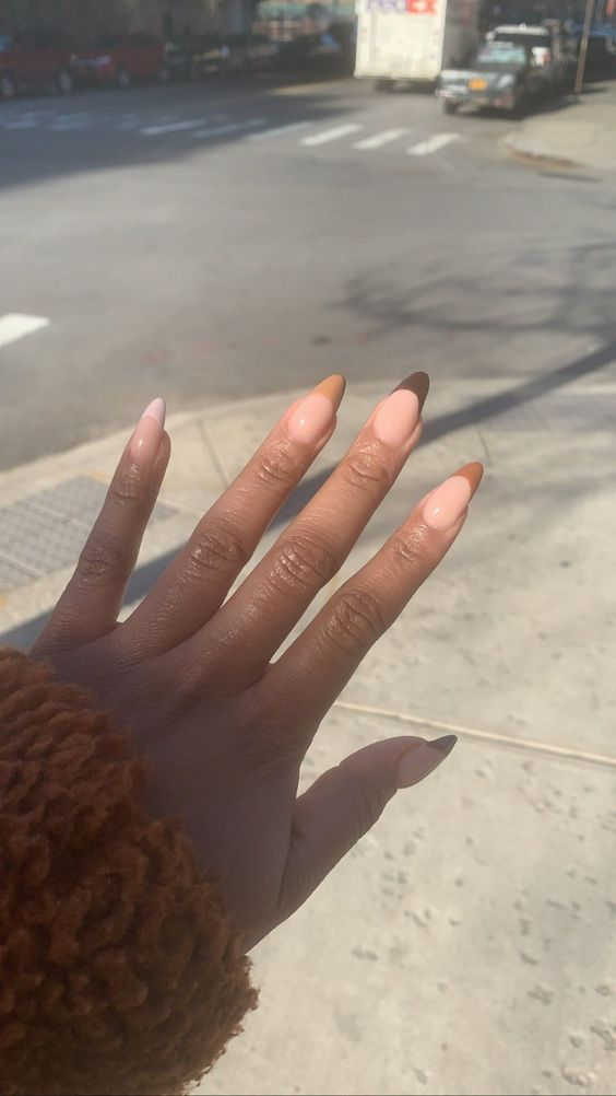 Brown French tip nails in almond shape