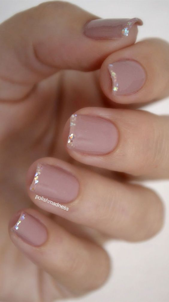 Short French tip nails with glitter