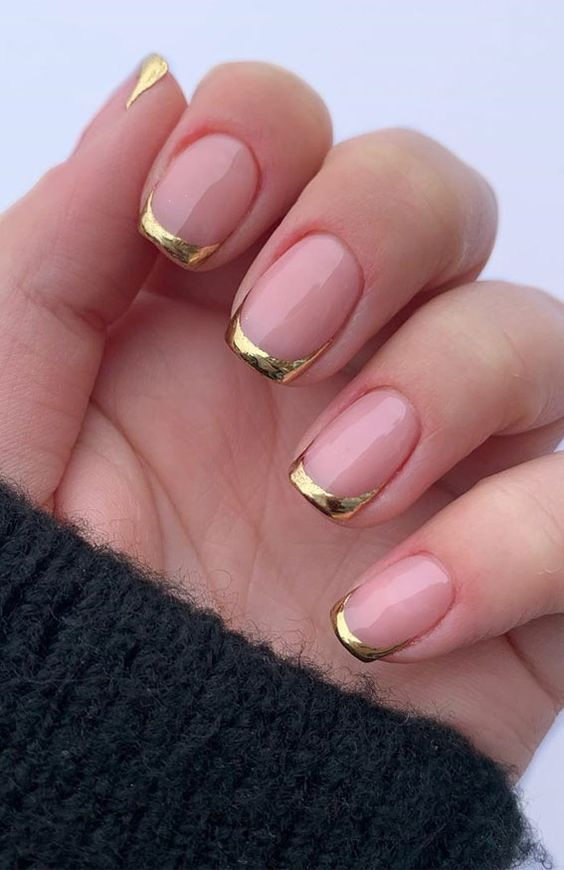 Gold French tip nails