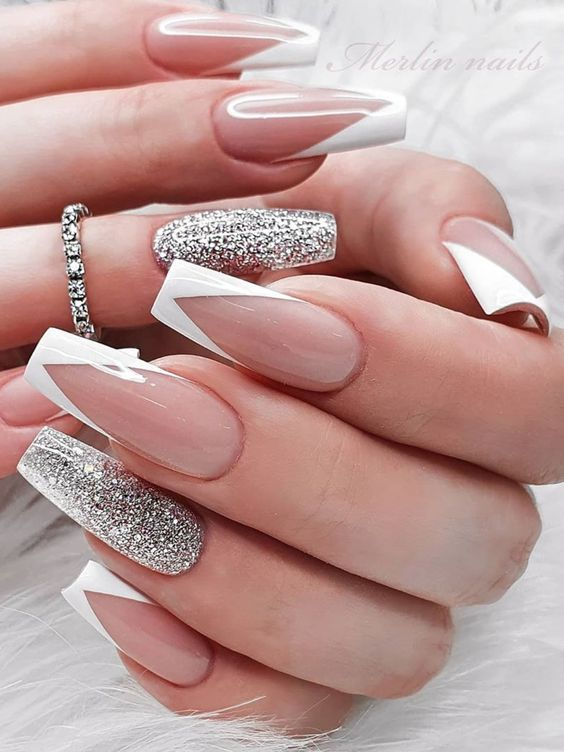 Modern French tip nails with silver glitter in acrylic coffin shape
