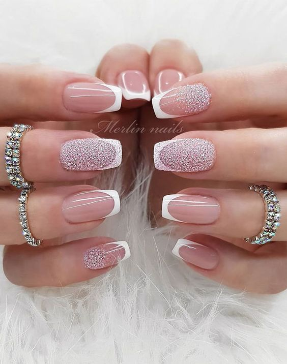 Classic French tip nails with glitter
