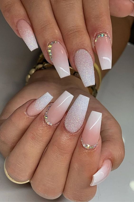 Pink and white ombre French tip nails with glitter