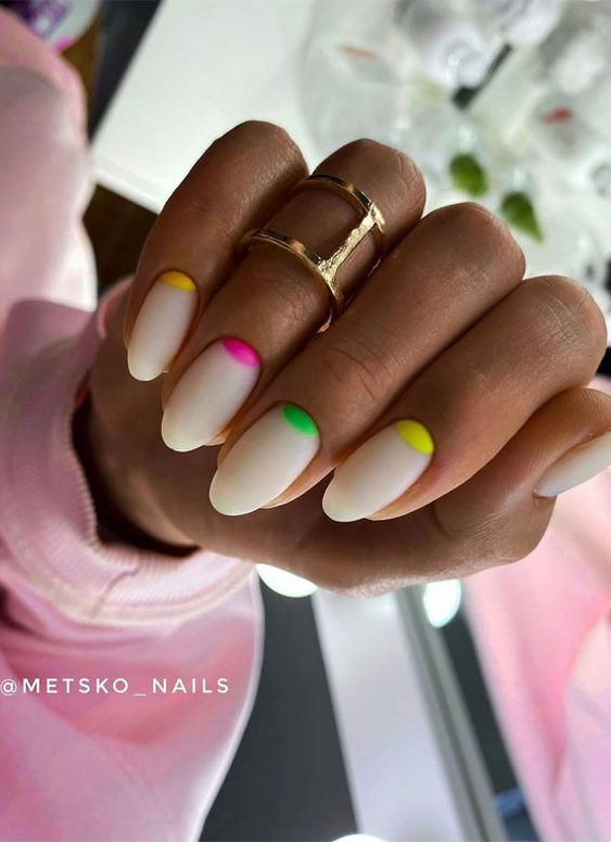 White and colorful half moon nails