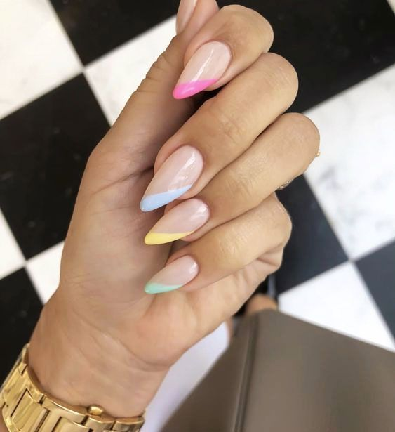 Colorful French tip nails in almond shape with pink, blue, yellow and green