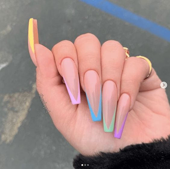Long colorful French tip nails in acrylic coffin shape