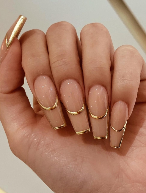 Gold French tip acrylic coffin nails
