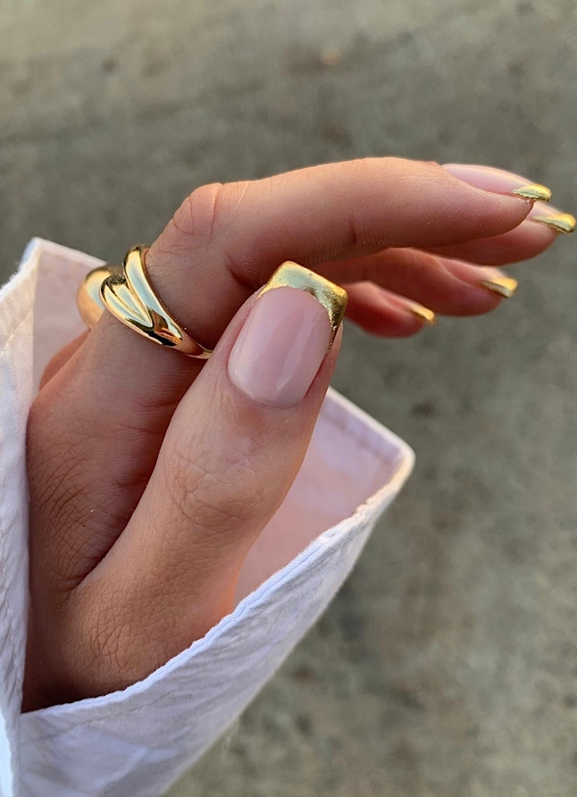 Gold French tip nails in square shape