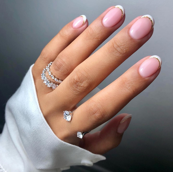 Short gold and white French tip nail designs