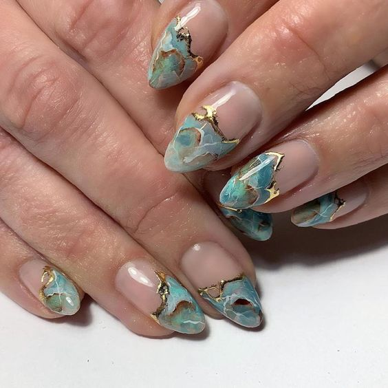 Mint green marble nails with gold