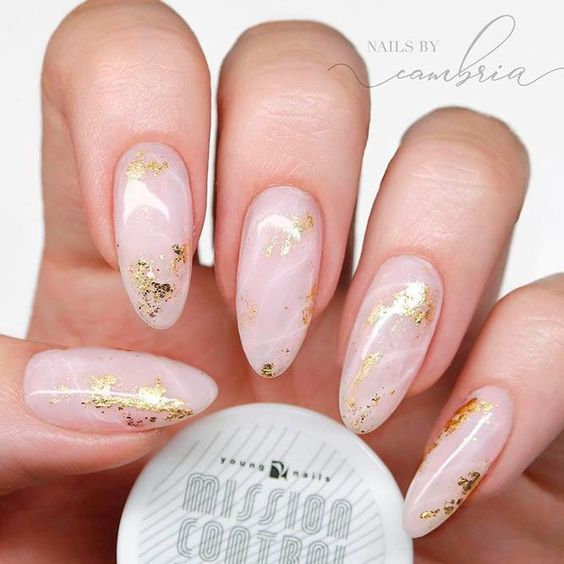 Pink marble nails with gold