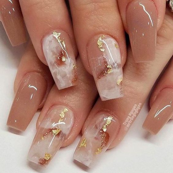 White and pink marble nails with gold foil