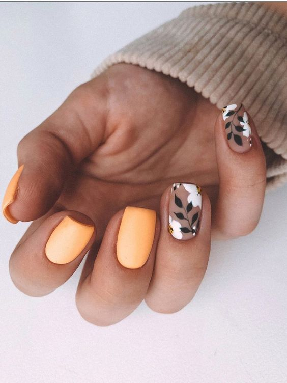Matte bright orange nails with flowers