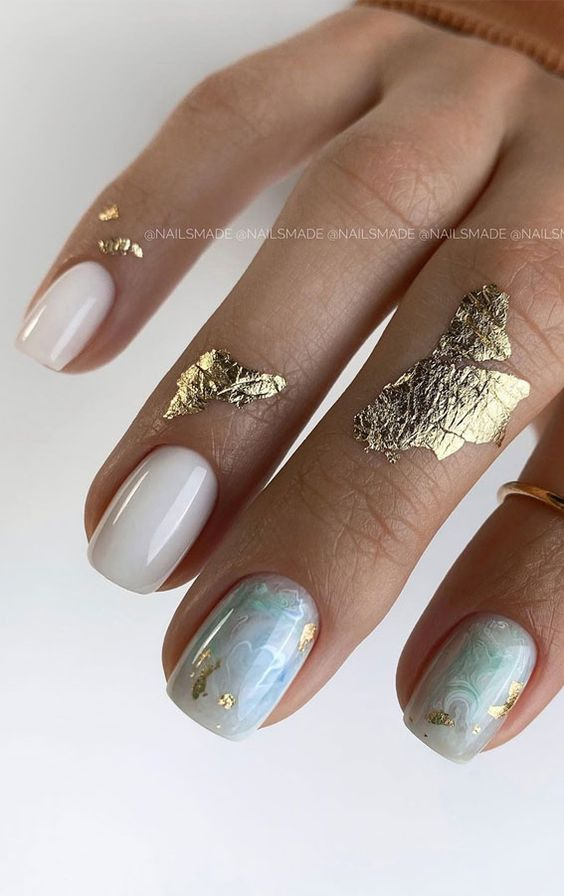 Short white and light blue nails with gold foil