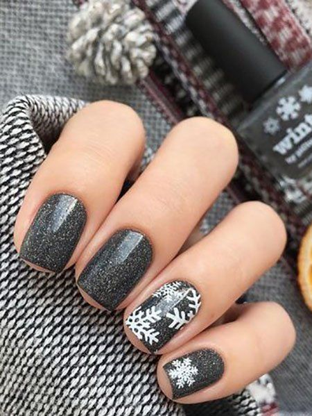 Black glitter nails with snowflakes