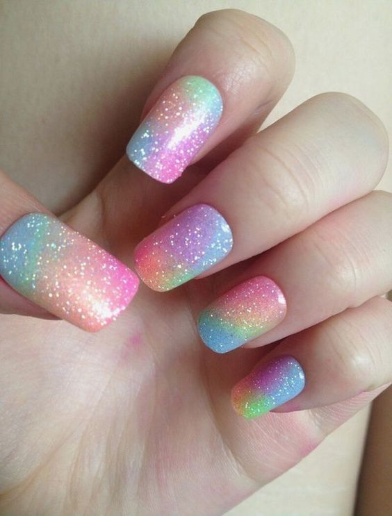 Cute pastel rainbow nails with glitter